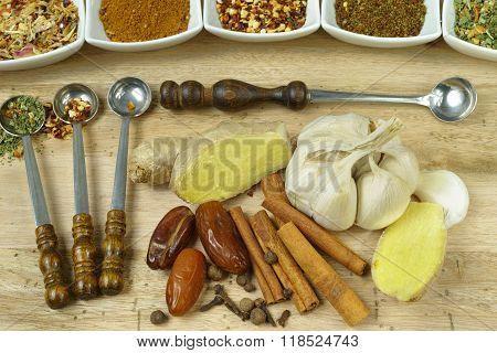 Set Of Spices And Seasonings With Vintage Spoons On Teak Wood