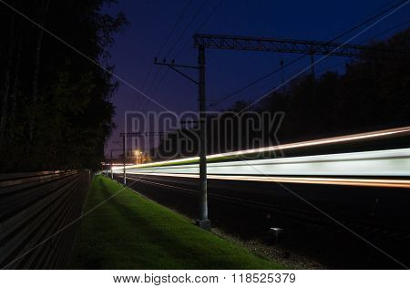Traffic On Railroad Tracks Through The Forest In The Evening