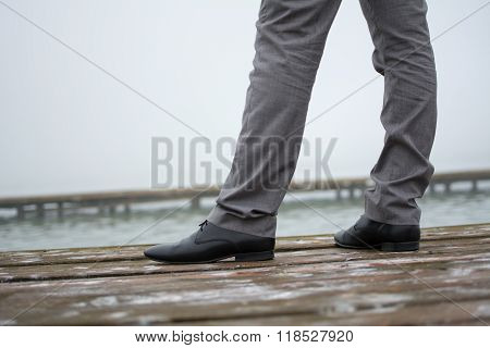Man in elegant trousers and shoes