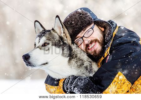a man with a beard and dog malamute