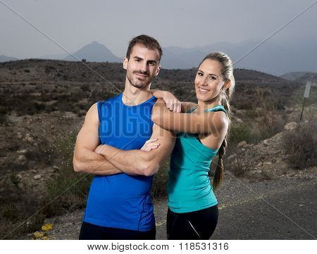 Young Sport Couple Posing Together Cool And Smiling Happy Girl Leaning On Man Shoulder