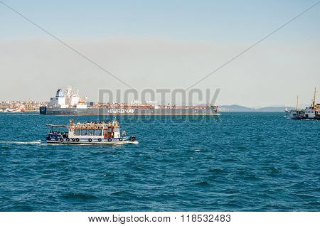 Tourist Boat And Cargo Boat In Istanbul Bosphorus Strait