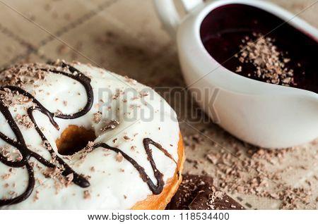 Donut With Jam Watered White Chocolate. Dark Chocolate, Milk Chocolate. Red Jam.