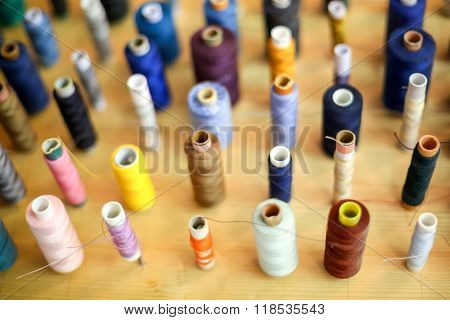 Threads Displayed On Wooden Board