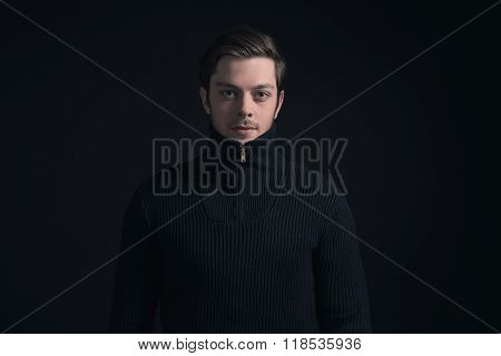 Man With Stubbly Beard Wearing Dark Blue Turtleneck.
