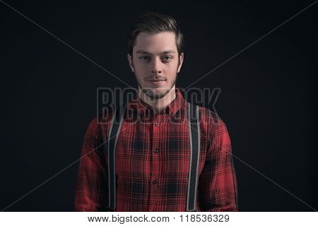 Fashionable Man In Red Checkered Shirt And Braces.
