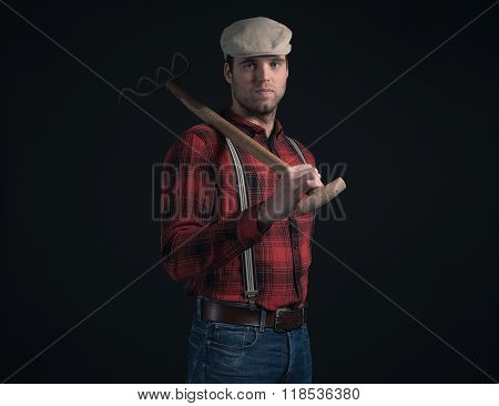 Cool Fashionable Farmer Wearing Red Checkered Shirt And Cap.