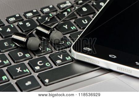 Headphones, Keyboard And Smartphone