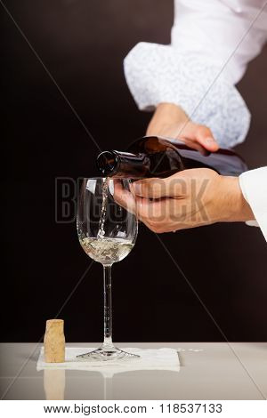 Man Waiter Pouring White Wine Into Glass.