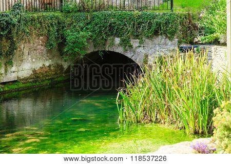 Old Bridge Over River Coln In Village Bibury England
