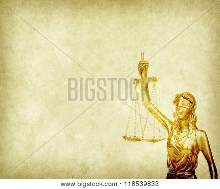Statue of justice on old paper backgroundl, law concept