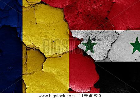 flags of Romania and Syria painted on cracked wall