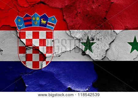 flags of Croatia and Syria painted on cracked wall
