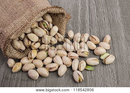 Pistachios On Wooden Table