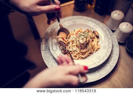 Traditional spaghetti with mussels meat and cream.Mussels with spaghetti in tomato sauce