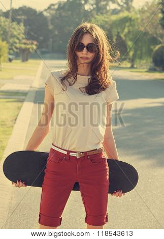 Beautiful Young Girl With Skateboard