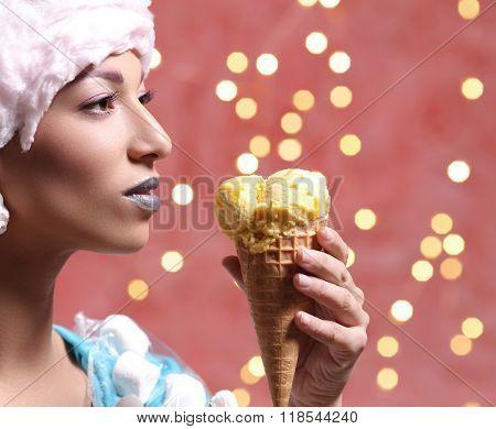 Weird. Woman in bizarre dress eats ice cream