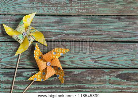 Homemade Paper Pinwheel On A Wooden Rustic Background . Vintage And Rustic Style