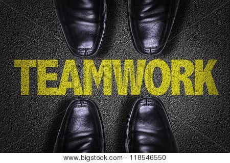 Top View of Business Shoes on the floor with the text: Teamwork