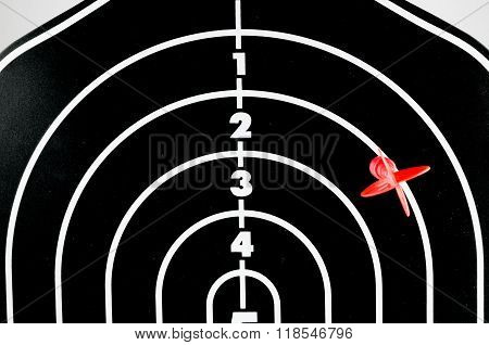 Red Arrow Shooting At Heart Position Of Profile Shape Black Dart Board