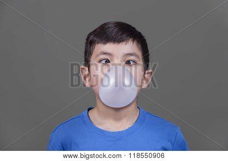 Boy Looks Down At Bubble Gum.