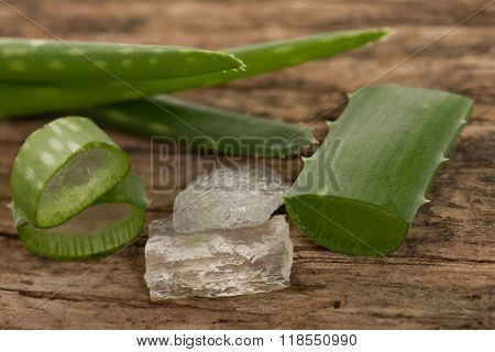 Aloe Vera Green Fresh Leafs Sliced And Aloe Vera Gel Decorated On Wooden Desk.