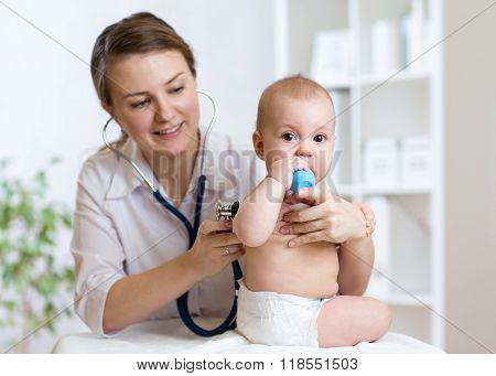 doctor listens to baby heart with stethoscope