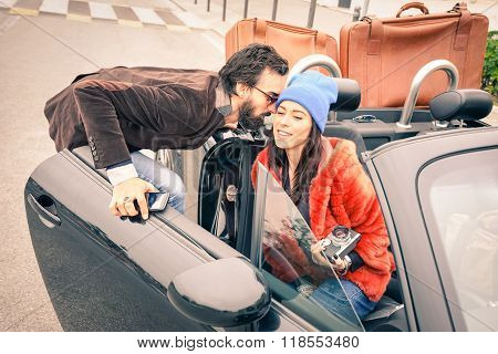 Confident Hipster Guy Having Fun With Fashion Girlfriend - Happy Couple Ready To Leave For Car Trip