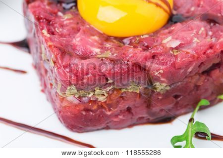 Delicious steak tartare with egg yolk.