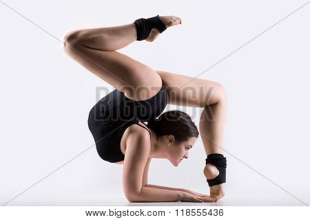 Young Woman Doing Gymnastics Handstand Exercise