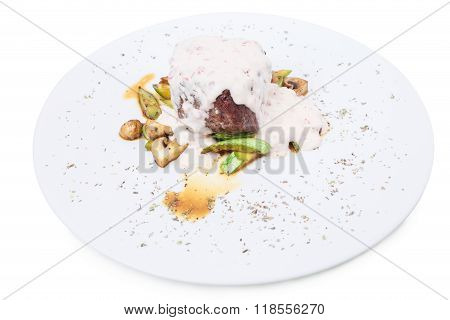 Grilled beef steak with vegetable garnish.
