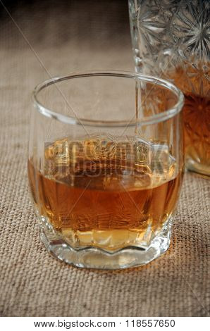 Carafe And Glass Of Whiskey, Whiskey Bourbon On A Burlap, Sacks  Background