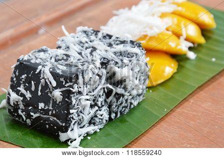 black coconut sweet pudding on banana leaf