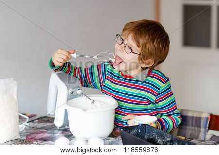 Funny Blond Kid Boy Baking Cake Indoors