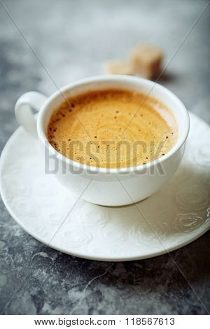 Cup of cafe crema on a stone background