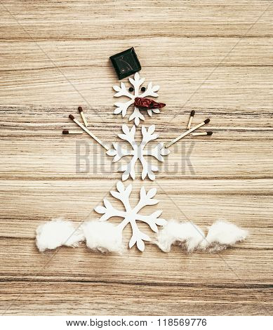 Beautiful Snowman Of Snow Flakes, Matches, Chocolate And Chili Peppers, Symbol Of White Winter
