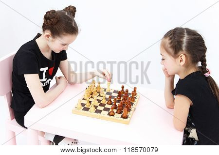 Two Girls Play Chess. White Bishop Move.