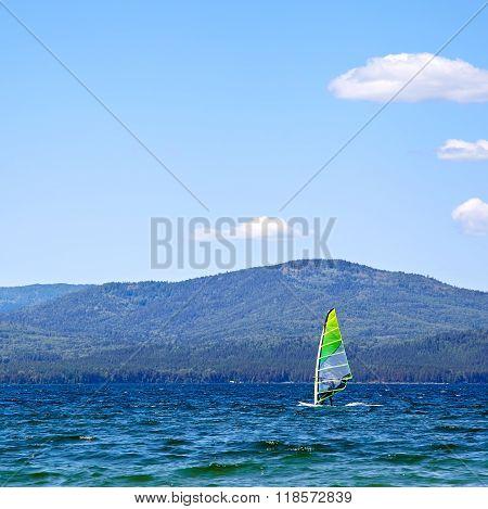 Yacht Sailing on a mountain lake