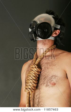 Man in gas mask with rope around his neck