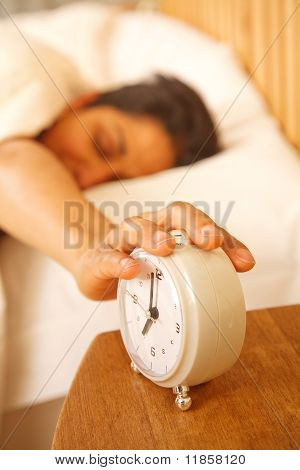 Woman Switching Off Alarm