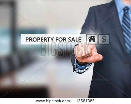 Businessman Pressing Property For Sale Button On Virtual Screen