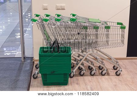 Shopping Carts And Baskets At The Entrance To The Commercial Premises. Trade