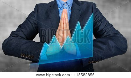 Businessman Praying And Wishing Hard