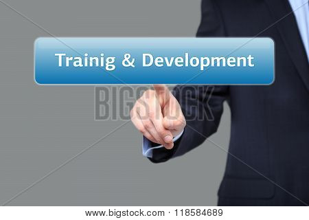 business, internet  concept - businessman pressing training and development button on virtual screen