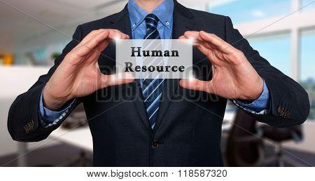 Businessman Holding Human Resource Sign