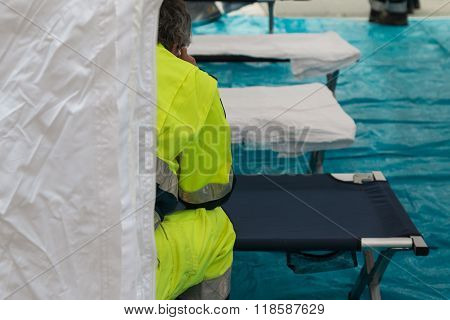 Paramedic Waiting For Emergency Inside Temporary Rescue Control Centre Tent