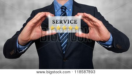 Businessman Holding White Card With Service Five Stars Sign, Grey - Stock Photo