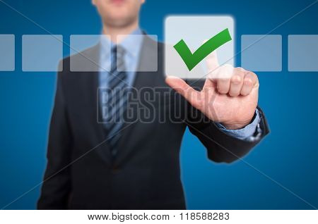 Businessman Touching Button And Green Ticking Check Box