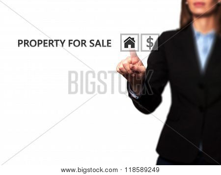 Businesswoman Pressing Property For Sale Button On Virtual Screen