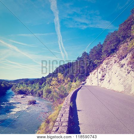 Asphalt Road along the River Bank in French Alps RetroEffect